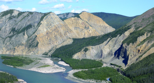 Photo 2013-239 : View looking east at dolostone of the Franklin Mountain Formation on the Keele River at the northern termination of the Redstone Range - light orange  ...