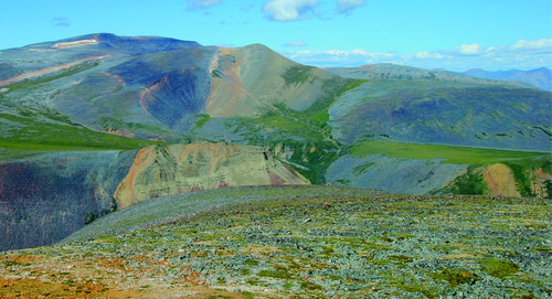 Photo 2013-240 : View looking north-northwest along the Conundrum Fault in the Tigonankweine Range of the Mackenzie Mountains - this steeply-dipping reverse fault,  ...