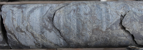 Photo 2014-188: BIF with pyrrhotite replacing magnetite layers along the SP1 fabric and remobilized in the FP2 fold limbs